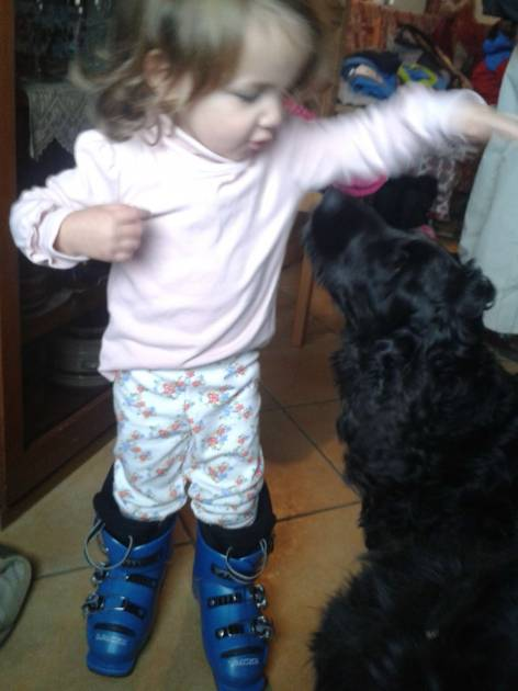 Our young friend trying on mummies boots whilst playing with Max